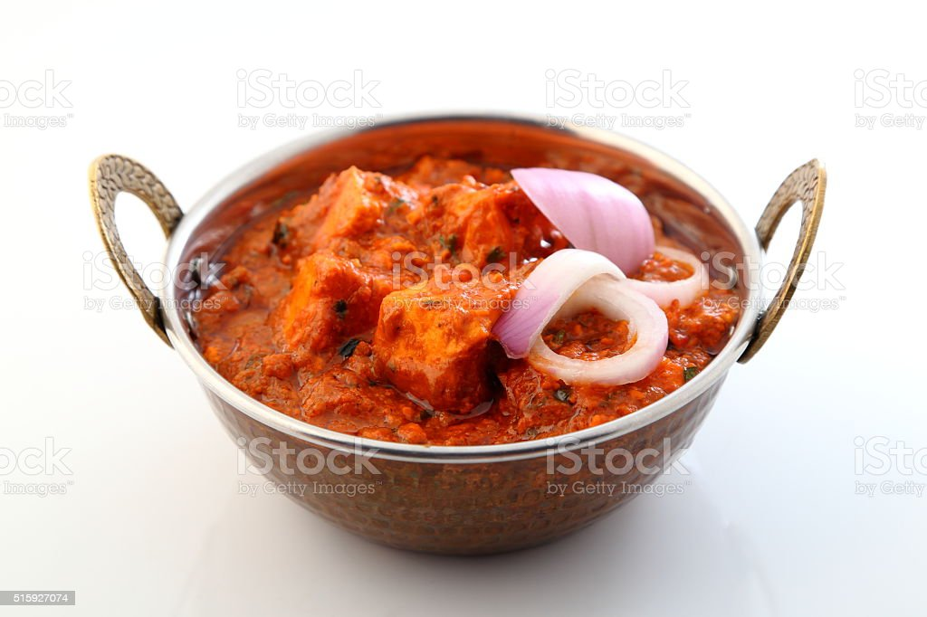 Indian style food or Indian Curry in copper brass bowl. stock photo