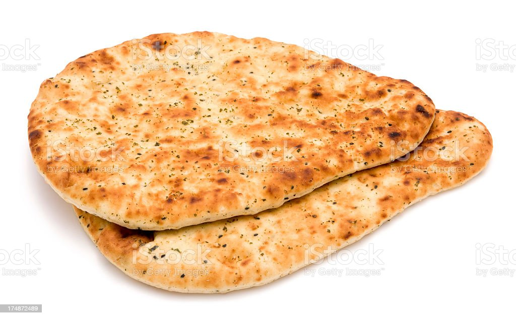Indian style naan bread on a white background stock photo
