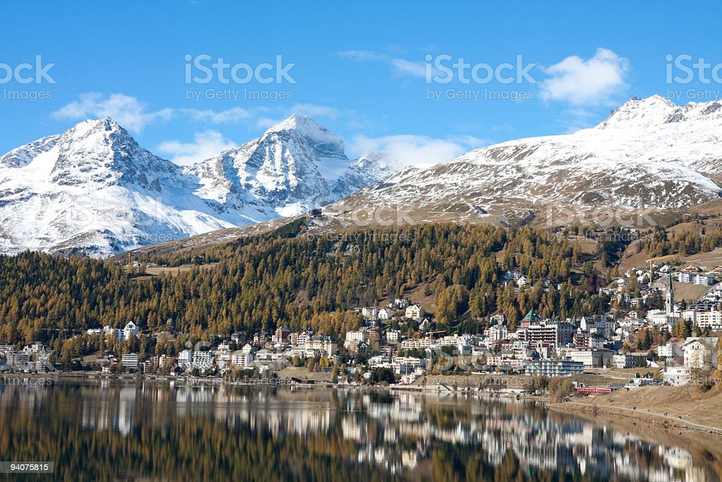 Indian Summer: St.Moritz Lake with yellow Larchs and Snow Mountains stock photo