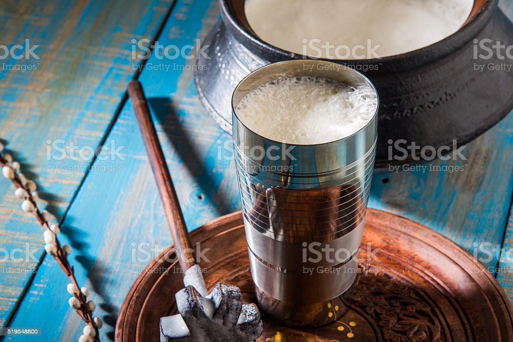 indian sweet lassi served in a big steel glass stock photo