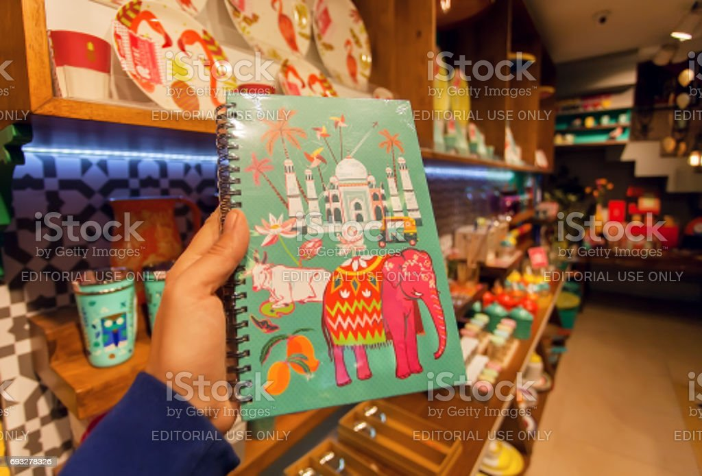 Indian symbols - Taj Mahal, cow and elephant on cover of notebook in souvenir store stock photo