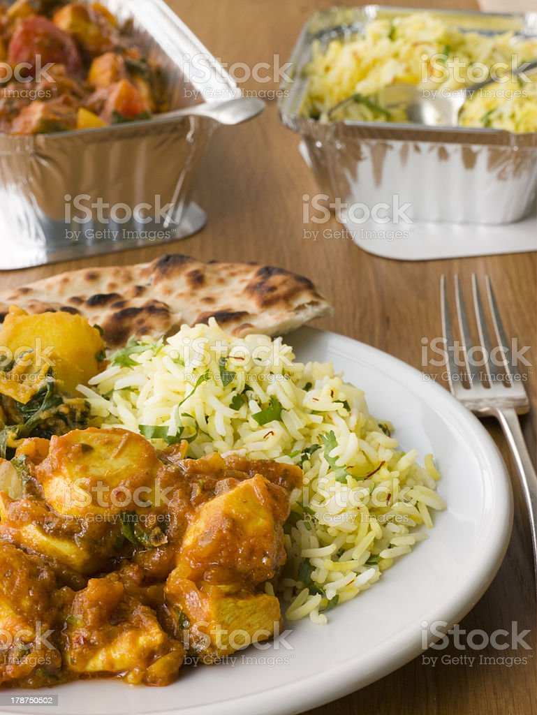 Indian Take Away- Chicken Bhoona, Sag Aloo, Pilau Rice royalty-free stock photo