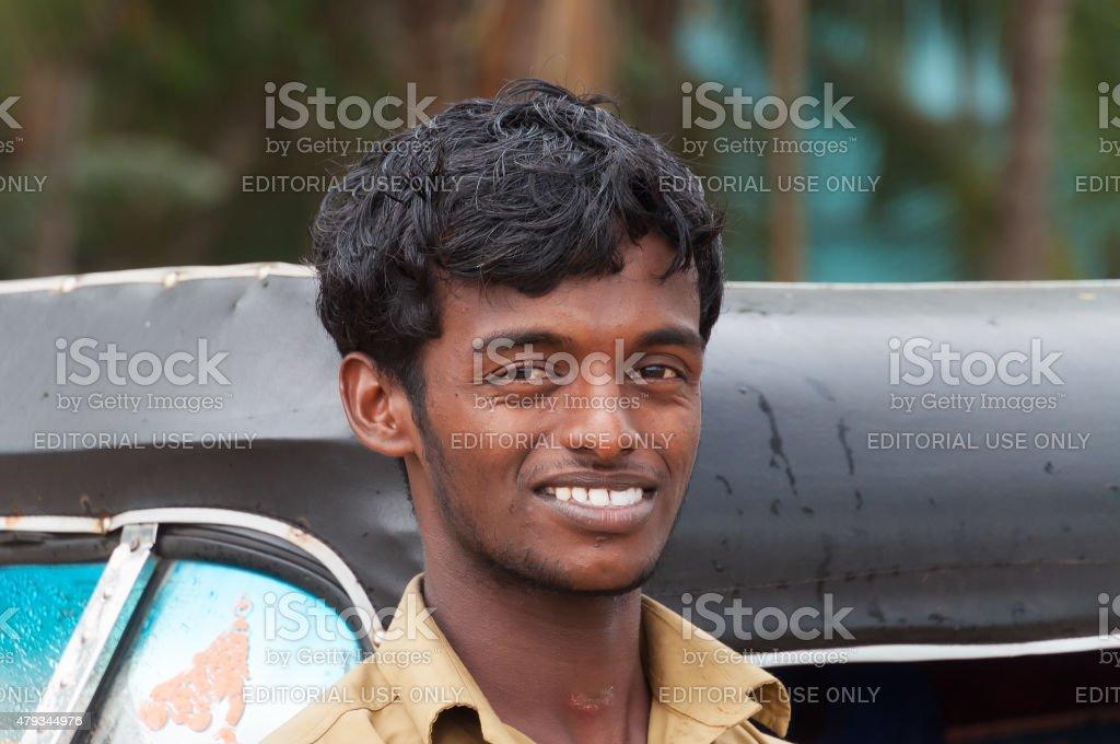 Indian taxi driver man of auto rickshaw stock photo