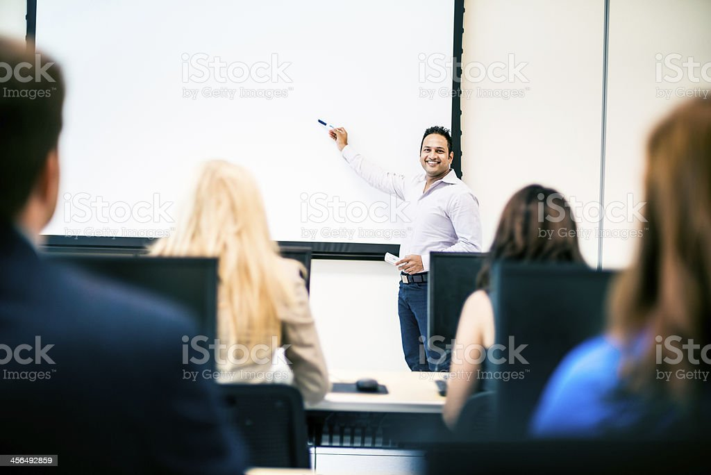 Indian Teacher using electronic whiteboard royalty-free stock photo