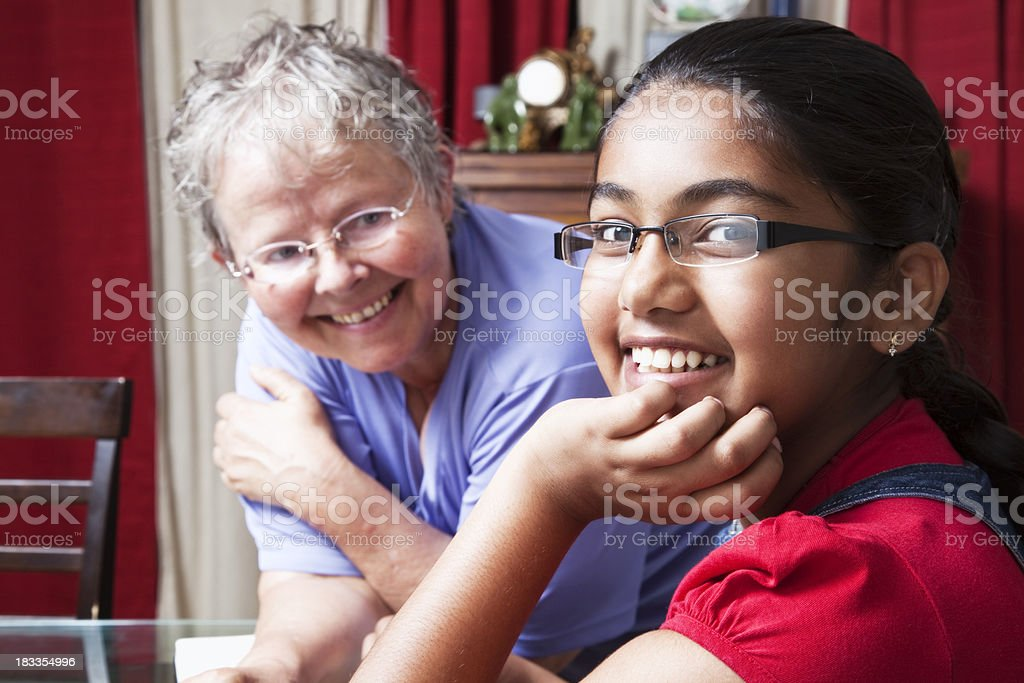 indian teenager and caucasioan senior woman royalty-free stock photo