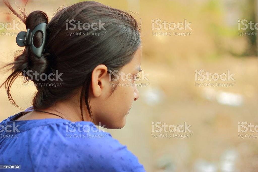 Indian teenager girl portrait with blurred natural background stock photo