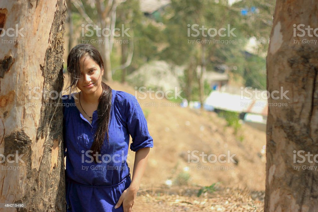 Indian teenager girl portrait with natural background stock photo