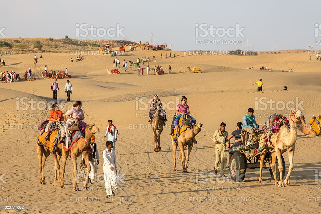 Indian tourists  riding camels in Thar desert, Rajasthan, India stock photo