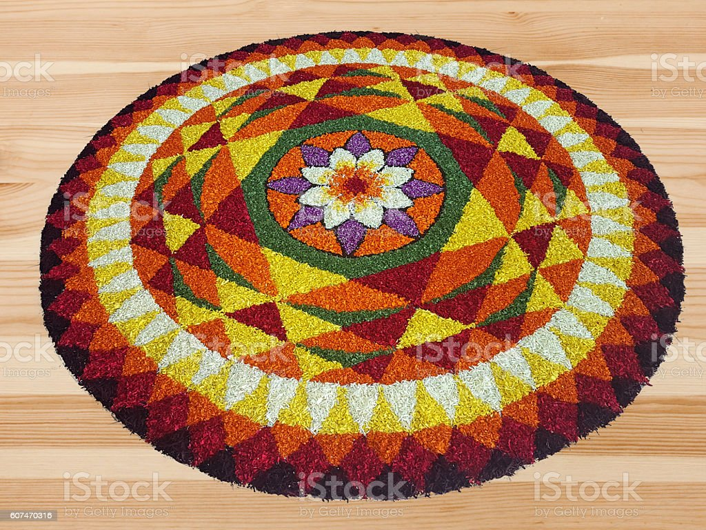 Indian traditional floral Boho art design on wooden floor stock photo