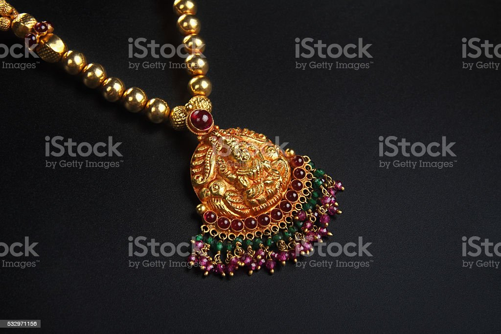 Indian Traditional Gold Necklace with Lakshmi Pendant stock photo
