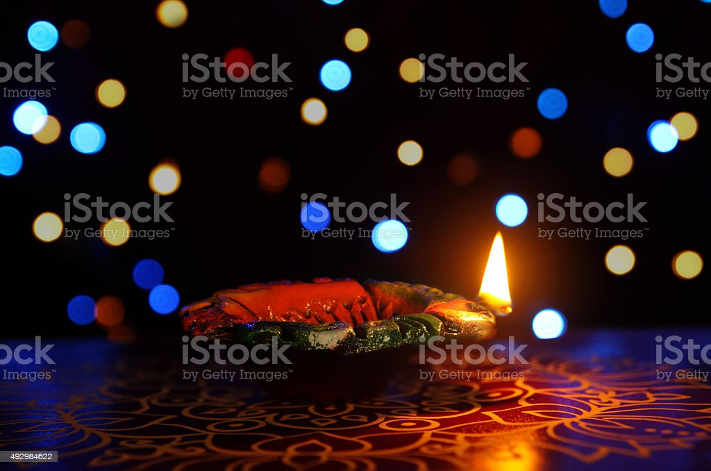 Indian Traditional kolam with Oil Lamp stock photo
