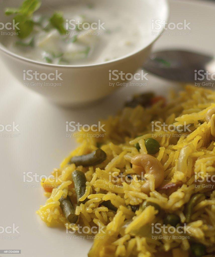 Indian Vegetable Pulav/Pilaf with Cucumber Raita royalty-free stock photo