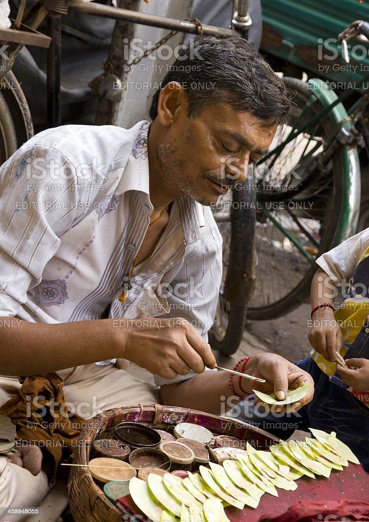 Indian wallah preparing paan stock photo