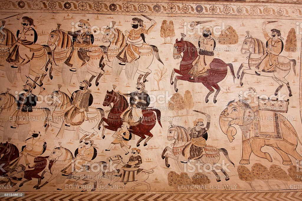Indian warlike horsemen on the mural in India. stock photo
