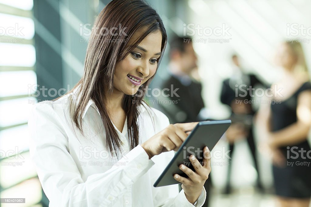 indian white collar worker using tablet computer royalty-free stock photo