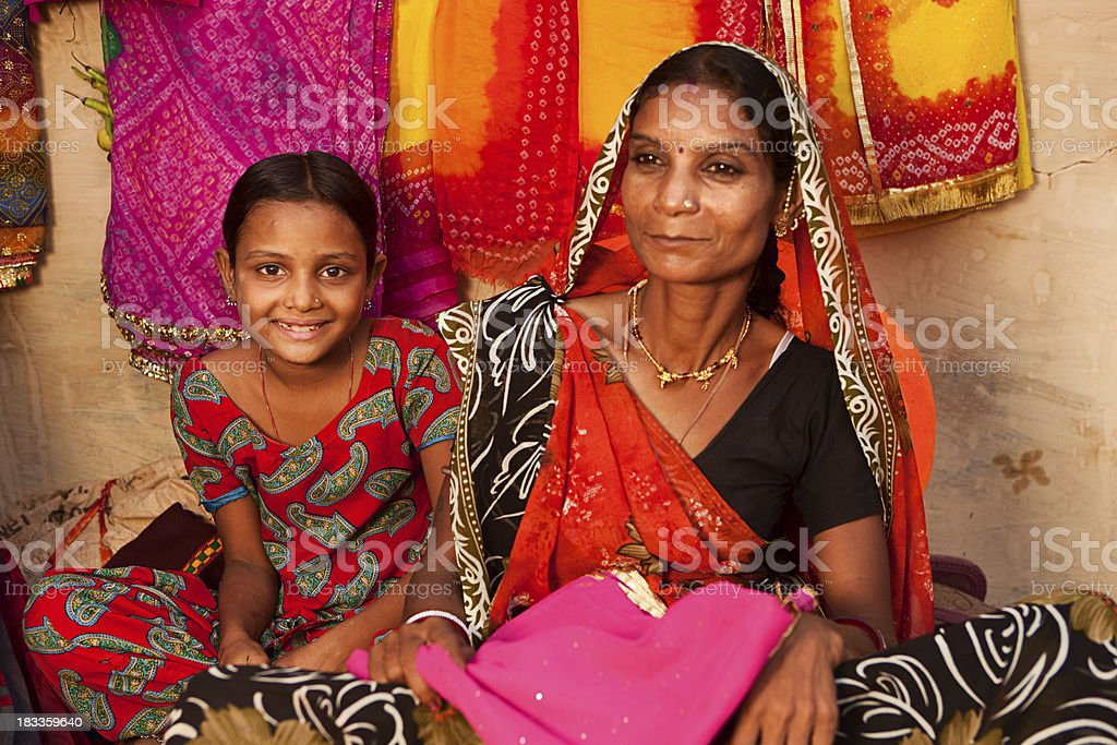 Indian woman and her daughter. stock photo
