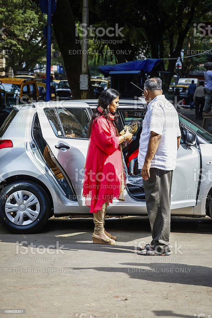 Indian woman and man outside their car royalty-free stock photo