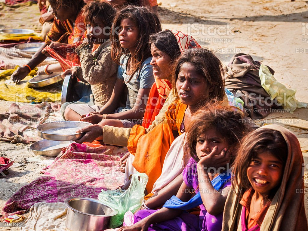 Indian Woman and Street Children Begging for Food, Allahabad, India stock photo