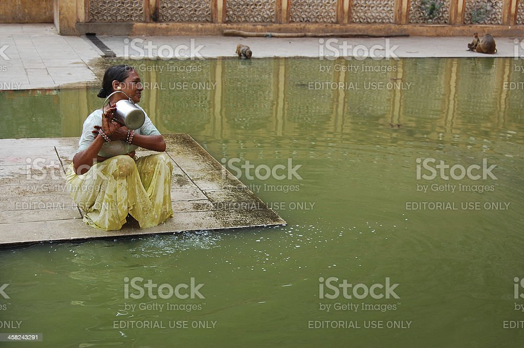 Indian Woman bathing in sacred water of Galtaji Temple royalty-free stock photo