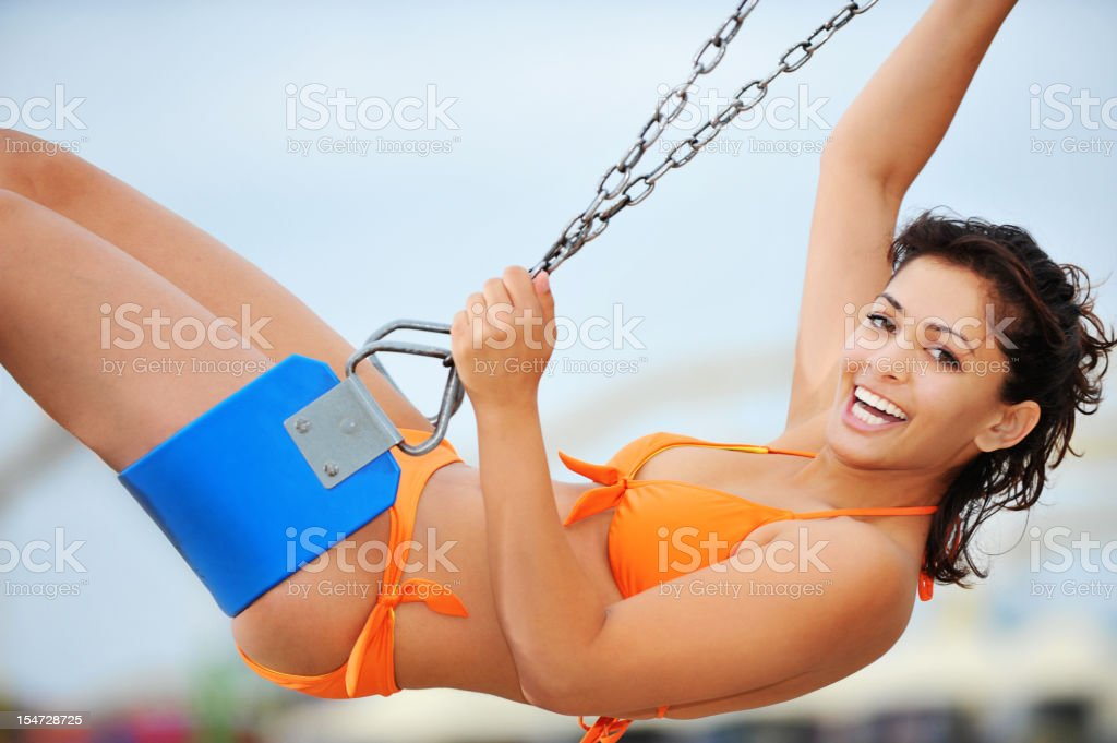 Indian Woman Bikini Model on Swing at Beach royalty-free stock photo