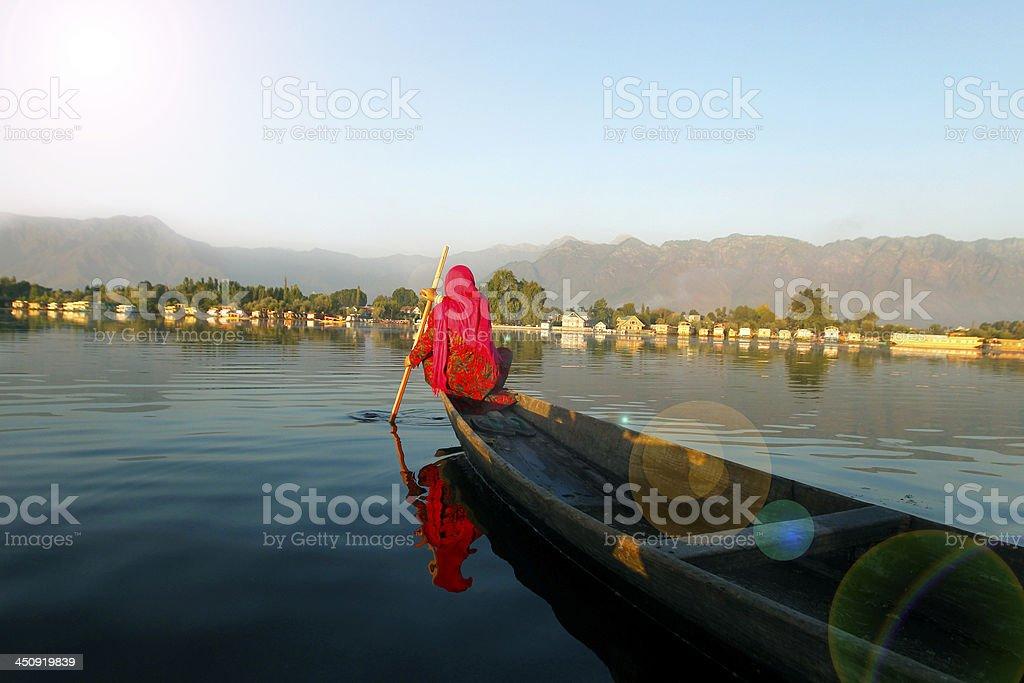 Indian Woman boating in Dal Lake, Srinagar, India. stock photo