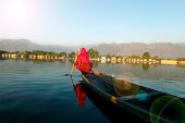 Indian Woman boating in Dal Lake, Srinagar, India.