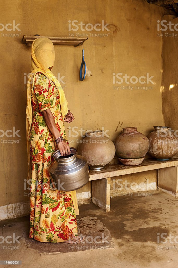 Indian woman carrying water from well. royalty-free stock photo