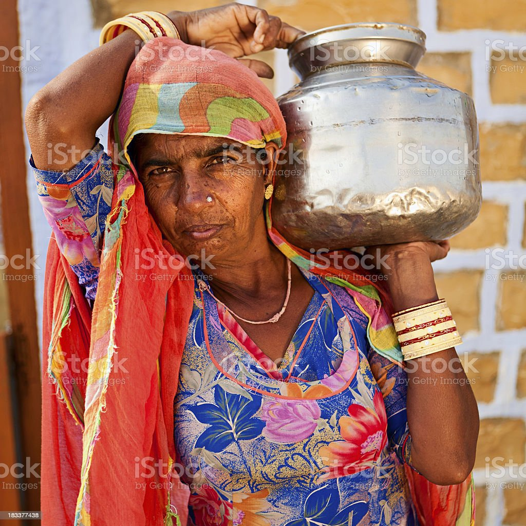 Indian woman carrying water from well royalty-free stock photo
