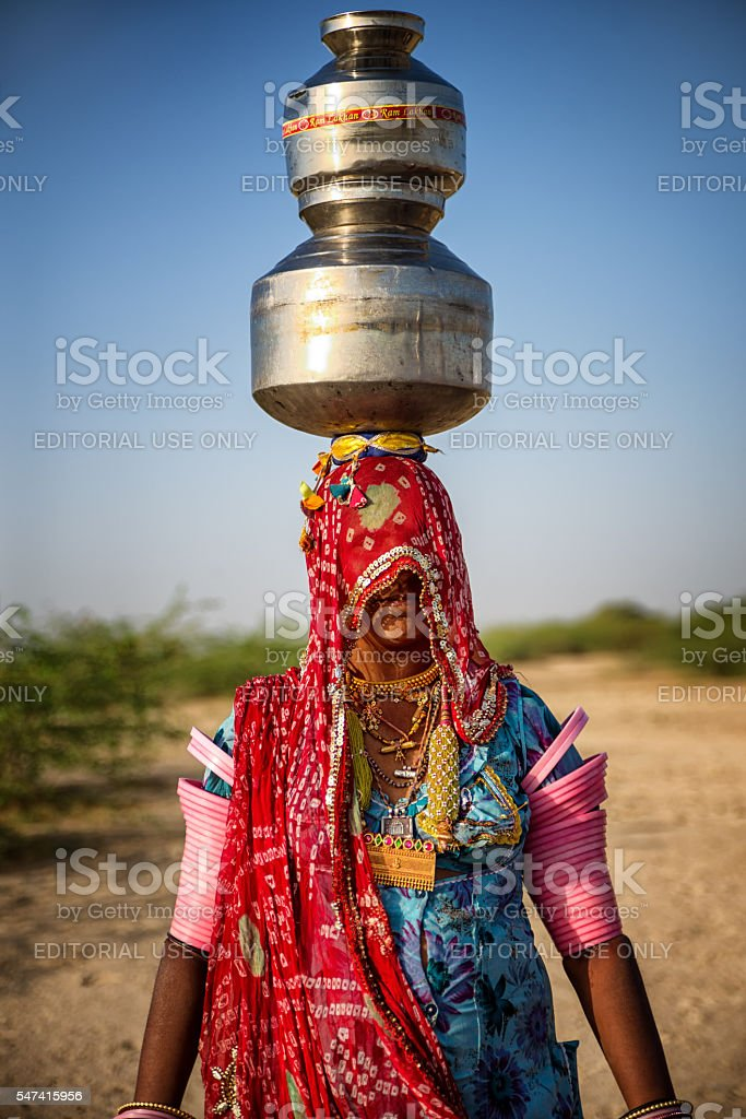 Indian woman carrying water stock photo