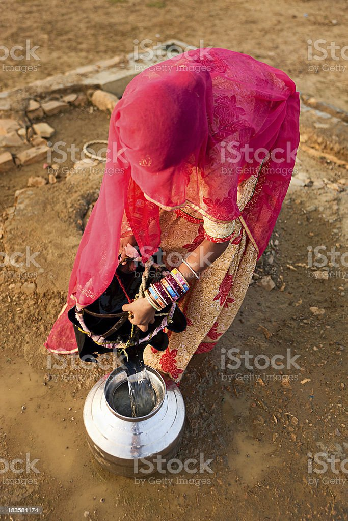 Indian woman carrying water. Rajasthan royalty-free stock photo