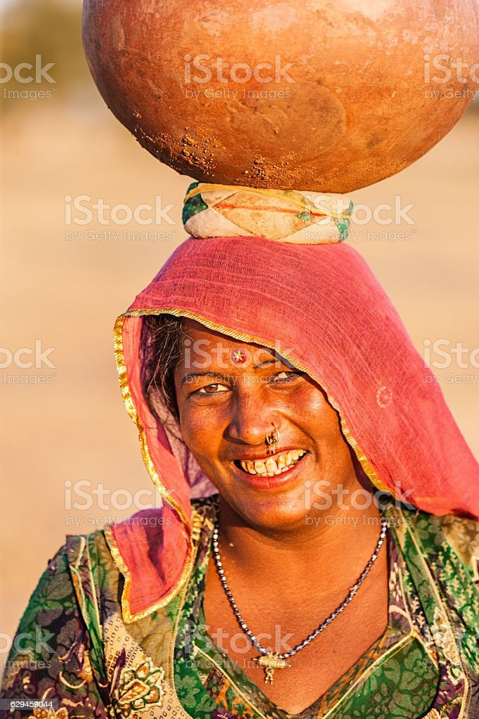 Indian woman carrying water, Rajasthan stock photo