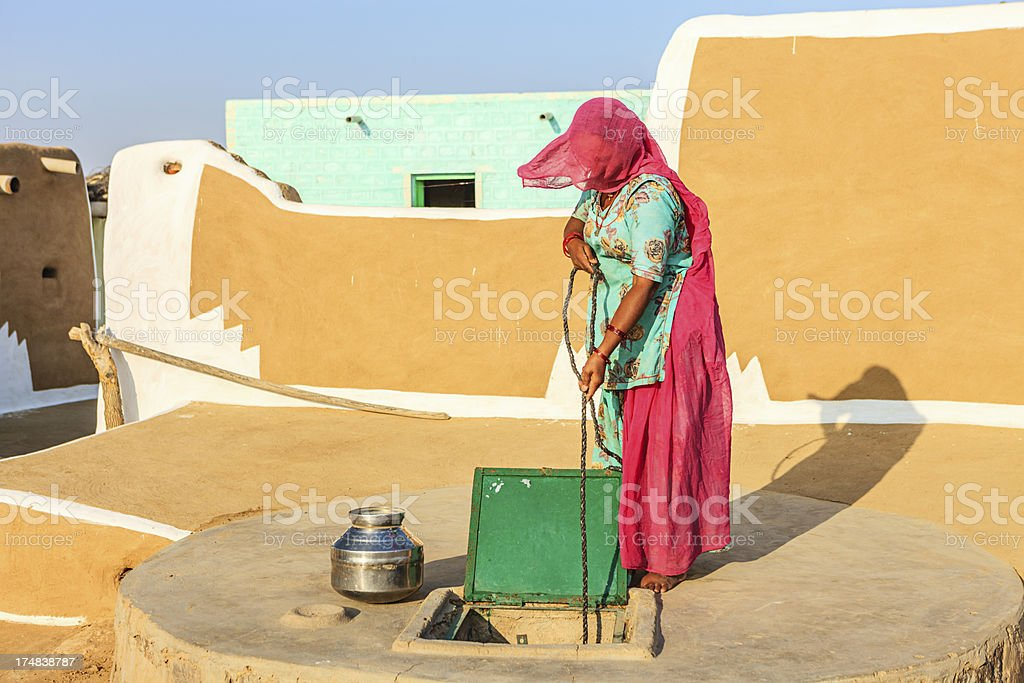 Indian woman collecting water, Rajasthan royalty-free stock photo