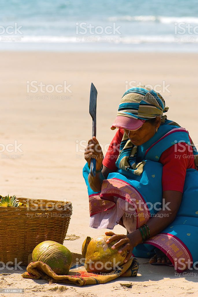 Indian woman cutting coconut royalty-free stock photo