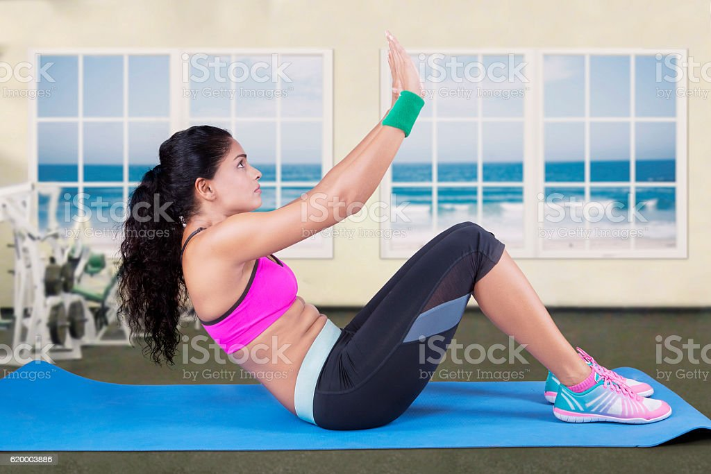 Indian Woman Doing Sit Ups stock photo