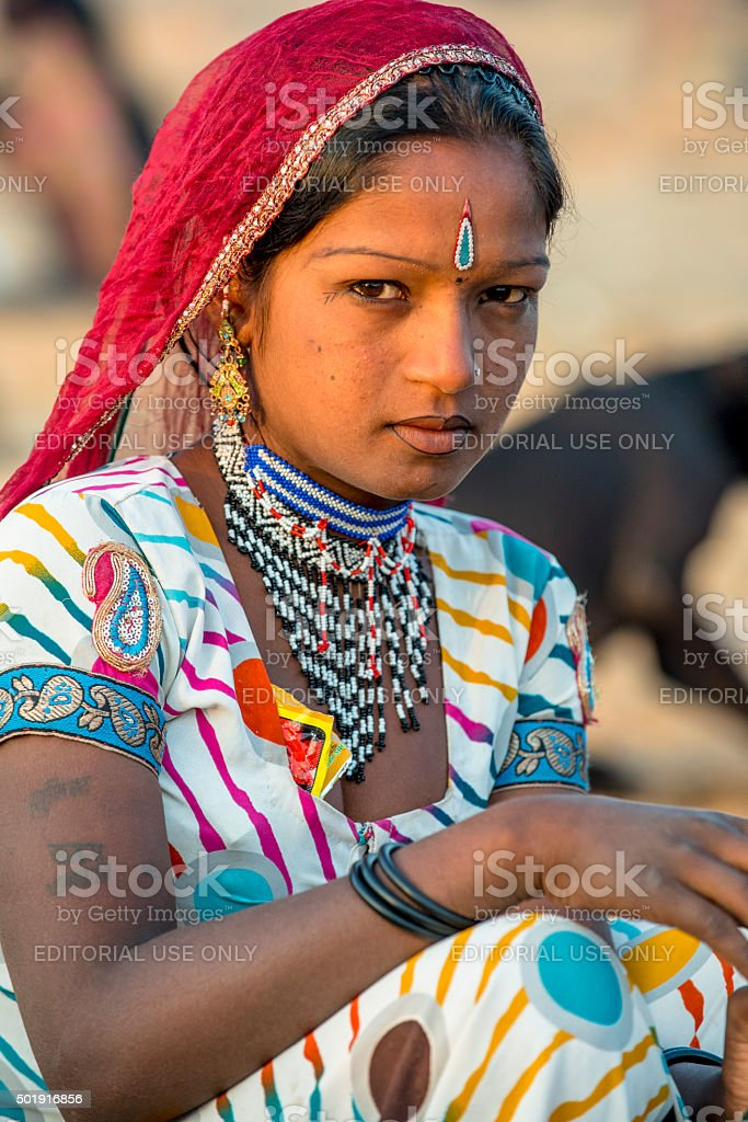 Indian woman dressing in traditional costume stock photo