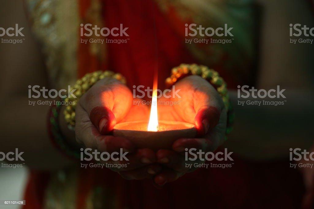 Indian woman holding Diwali oil lamp stock photo