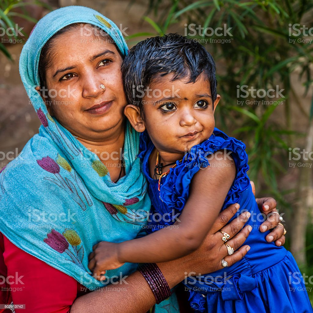 Indian woman holding her daughter, Jaipur, India stock photo