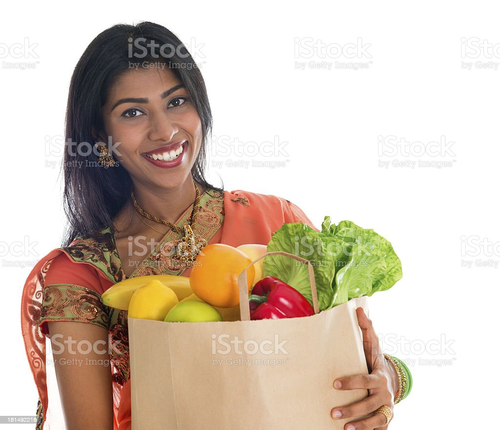 Indian woman in sari dress groceries shopping royalty-free stock photo