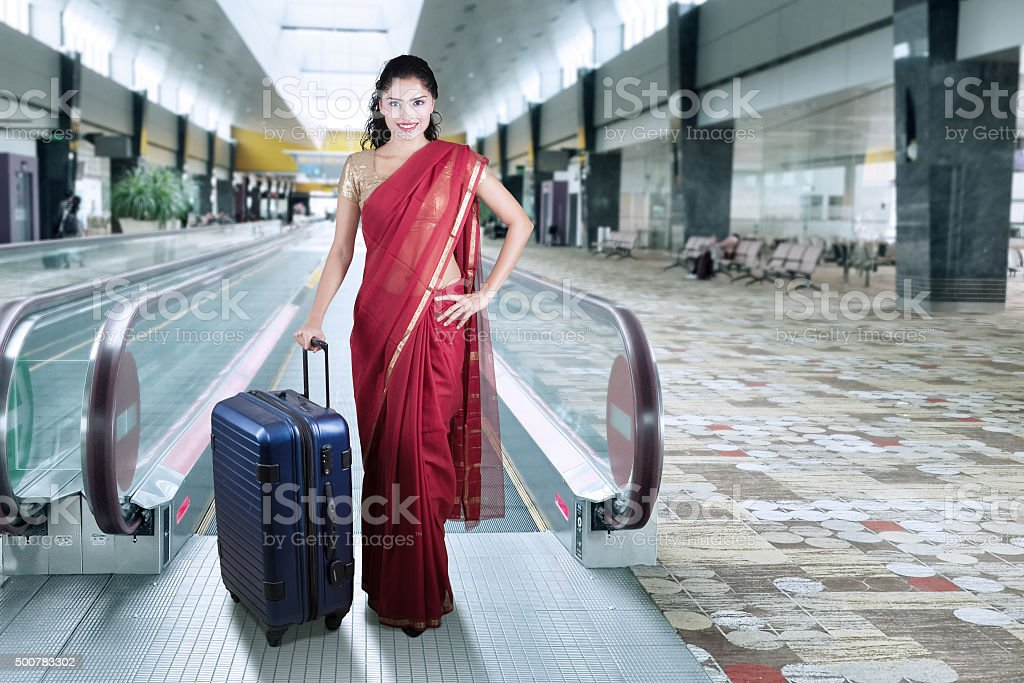 Indian woman in the airport hall stock photo