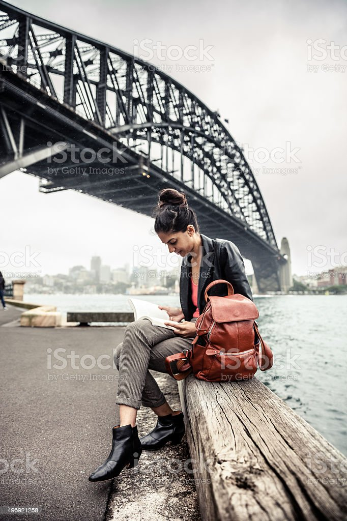 Indian woman in the city of Sydney reading a book stock photo