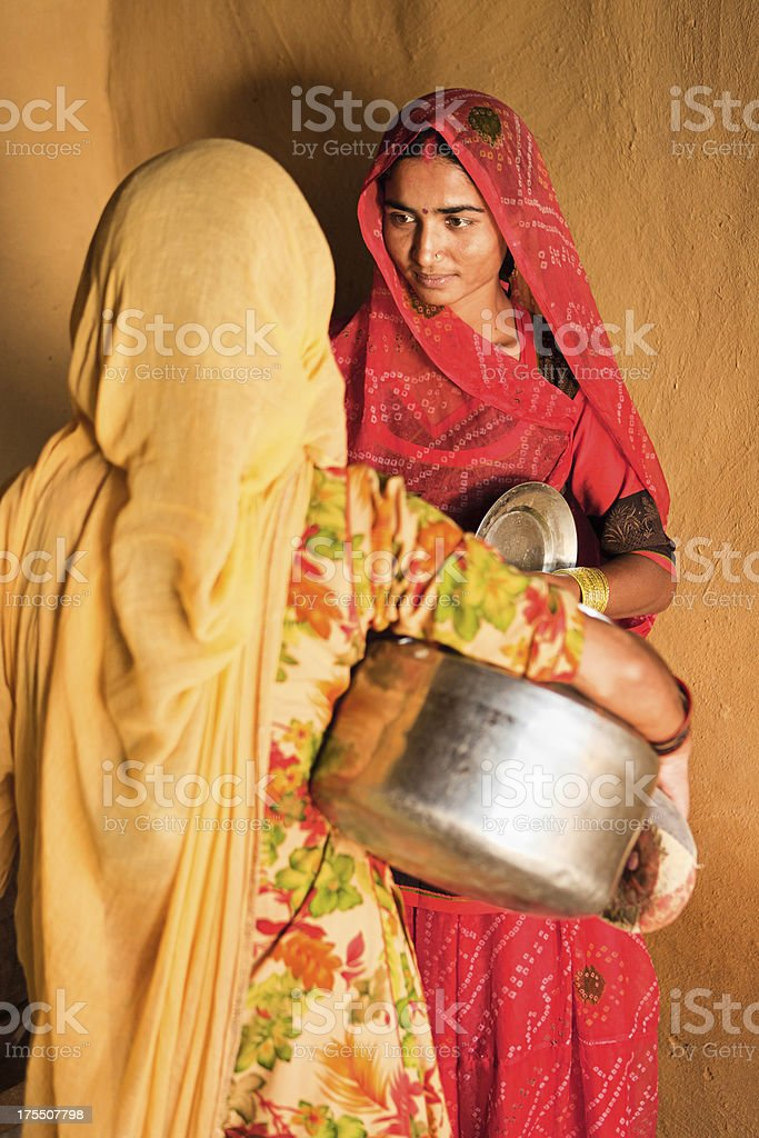 Indian woman in traditional clothing talking with each other royalty-free stock photo