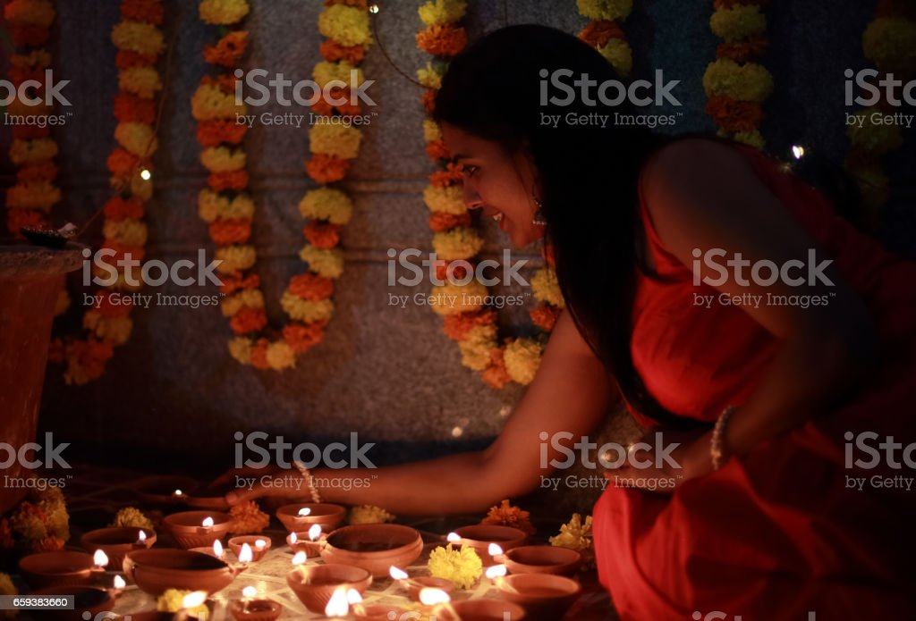 Indian Woman Lighting Oil Lamps stock photo