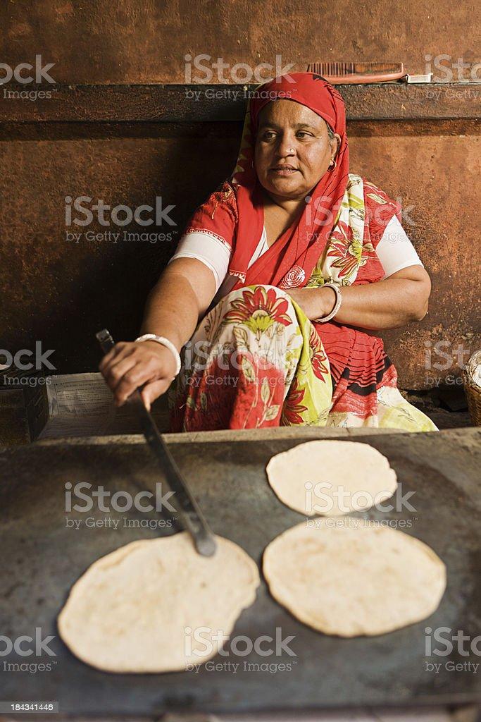 Indian woman making chapatti. stock photo