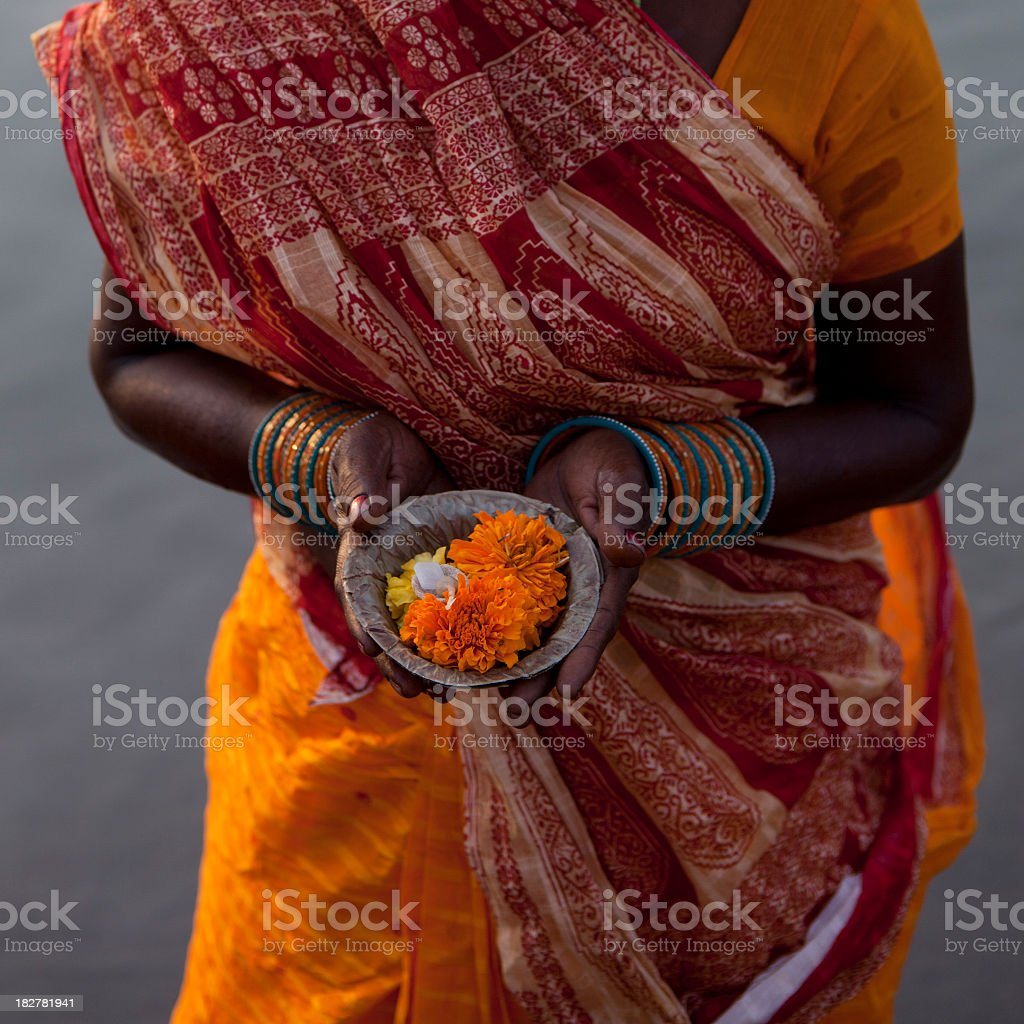 Indian Woman  Offering (Puja)  For The Gods In Varanasi stock photo