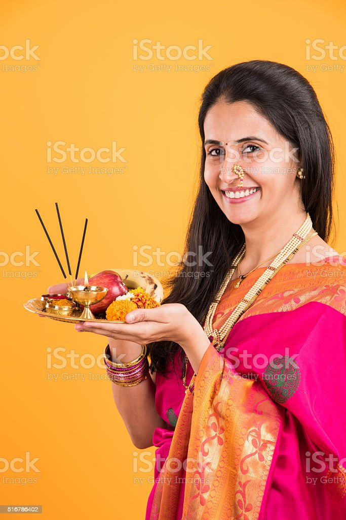 Indian woman performing puja, indian girl with pooja thali stock photo