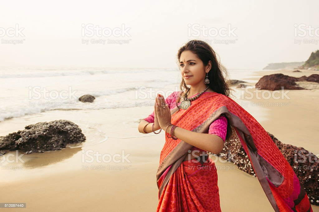Indian woman praying on the nature stock photo