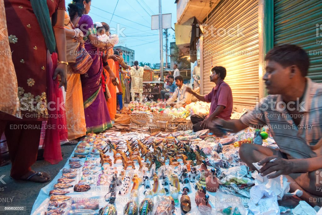Indian woman purchasing ornaments. stock photo