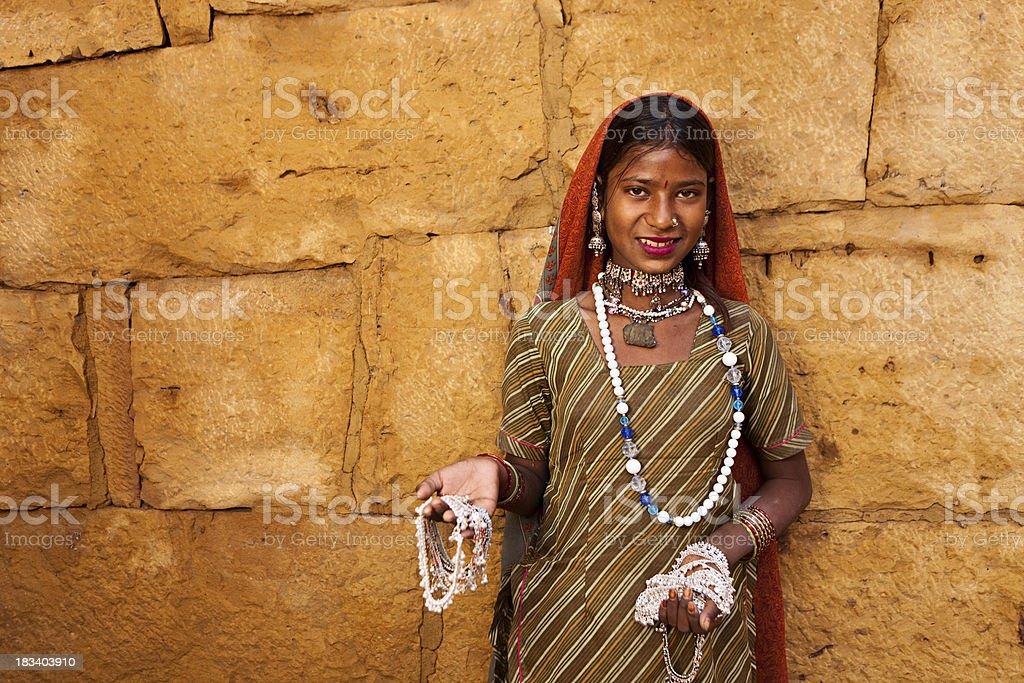 Indian woman selling souvenirs royalty-free stock photo