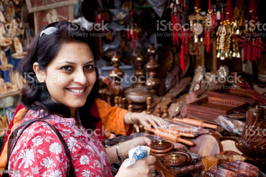 Indian woman shopping in a roadside shop Horizontal Natural Light royalty-free stock photo