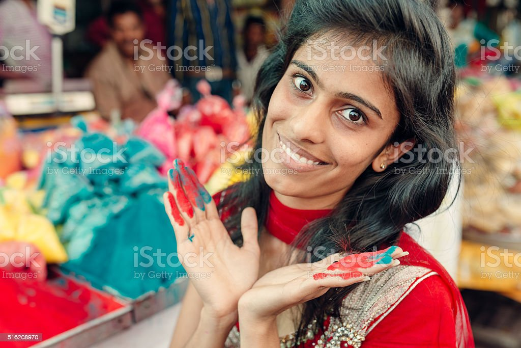 Indian Woman Shopping shop for paint powder, Jaipur, Rajasthan, India stock photo